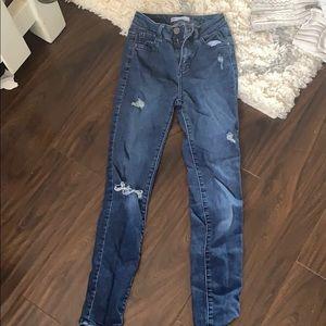 Tillys dark blue jeans